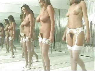 Brunettes dance nude round..