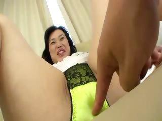 Asian milf shows her goods..