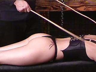Brunette in leather bustier..