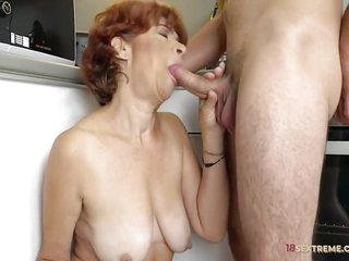 Redhead Granny Riding a Hard..